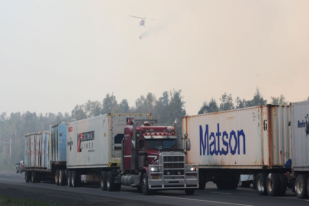 Truckers head south after turning around on the Parks Highway as strong winds advanced the McKinley fire on Sunday, Aug. 18, 2019. (Bill Roth / ADN)