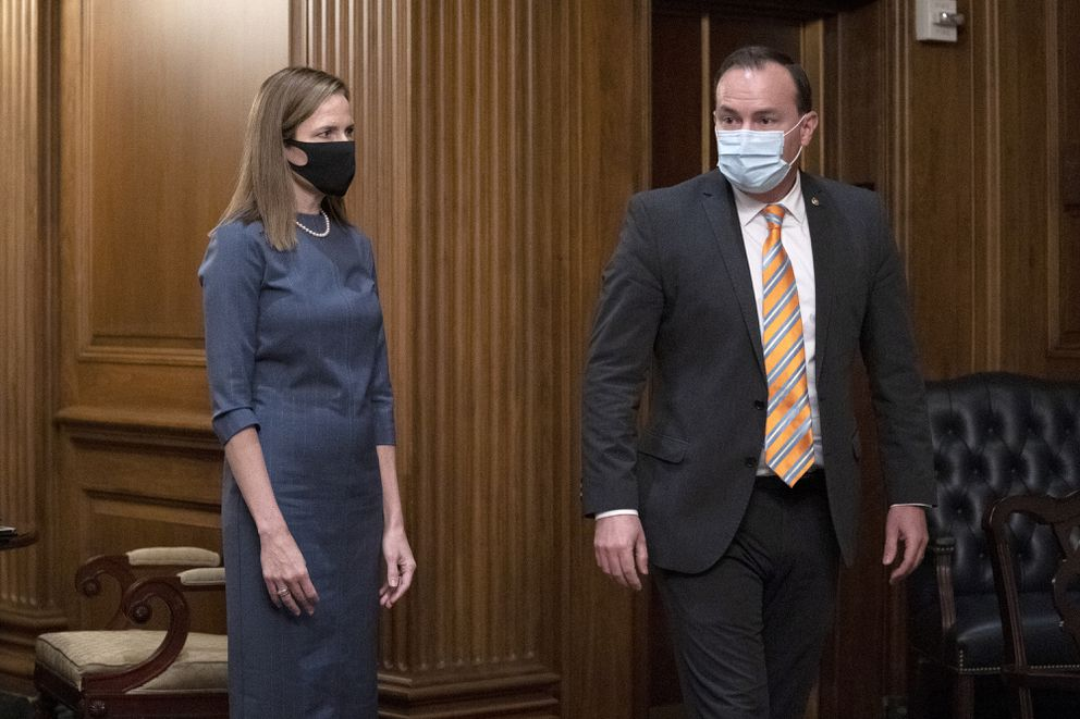 In this Sept. 29, 2020, photo, Judge Amy Coney Barrett, President Donald Trump's nominee to the Supreme Court, meets with Sen. Mike Lee, R-Utah, at the Capitol in Washington. Hours after President Donald Trump announced he had tested positive for the coronavirus, Lee revealed he too had been infected with the disease. (Stefani Reynolds/Pool via AP, File)