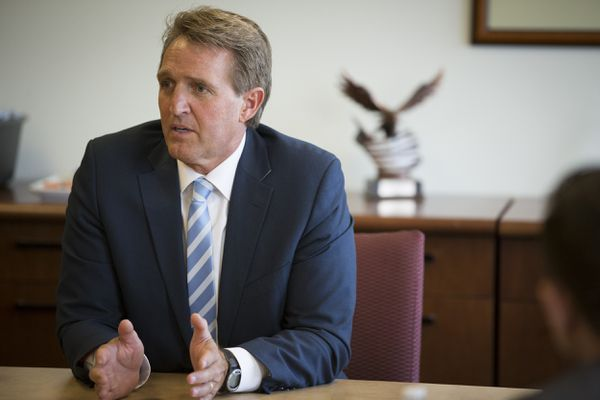 """Sen. Jeff Flake, R-Ariz., speaks with insurance executives at a campaign event in Phoenix, Aug. 23, 2016. With the West trending younger and less white, many Republicans in the region are saying that their best hope is to distance themselves from Donald Trump. """"I think we've got to do it if we're concerned not just about this election but elections to come,"""" Flake said. (Caitlin O'Hara/The New York Times)"""