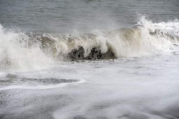 In this September 24, 2015 file photo, waves crash on the beach near an archaeological site in Barrow. Recent research using materials from a Barrow beach sought to learn more about what happens to oil spilled in such an environment.