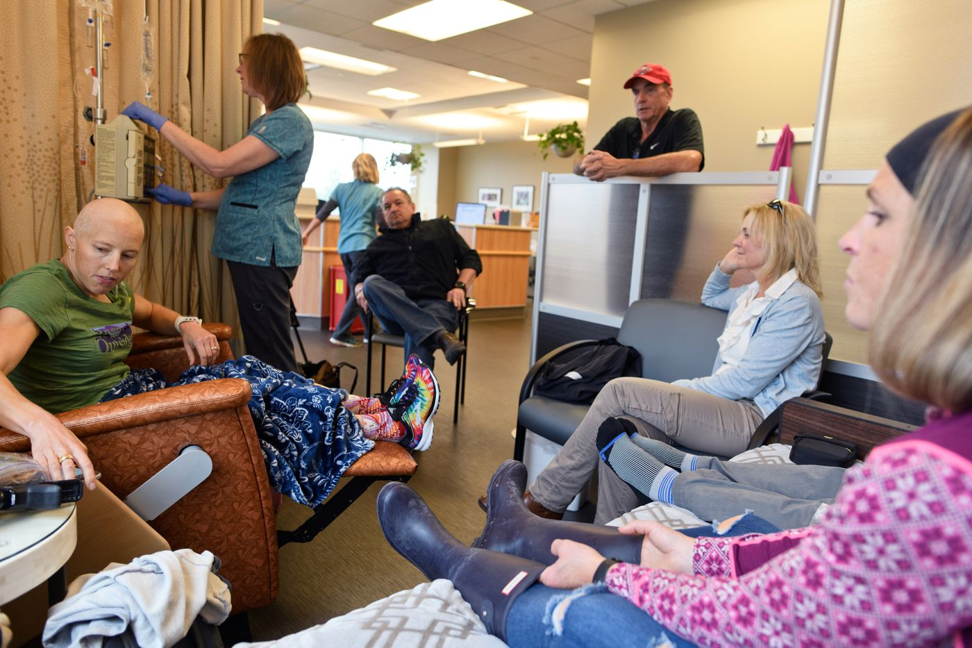 Friends and supporters surround Kikkan Randall during a chemotherapy treatment at Katmai Oncology on Aug. 21. (Marc Lester / ADN)