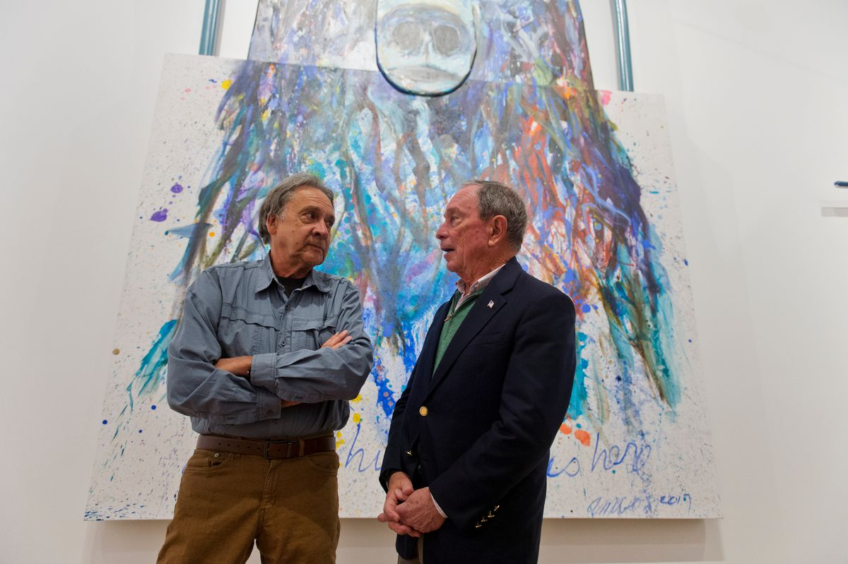 "Artist Alvin Amason talks with Michael Bloomberg at the Anchorage Museum on Nov. 7, 2018. Amason's piece ""Everything I Love Is Here"" is displayed behind them. (Marc Lester / ADN)"