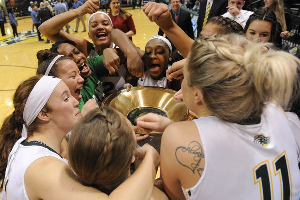 The UAA team pretends to eat out of the championship gold pan after defeated Tulsa in the Championship game of the 2017 Great Alaska Shootout 59-53 at the Alaska Airlines Center in Anchorage, Alaska on Thursday, Nov. 23, 2017. (Bob Hallinen / ADN)