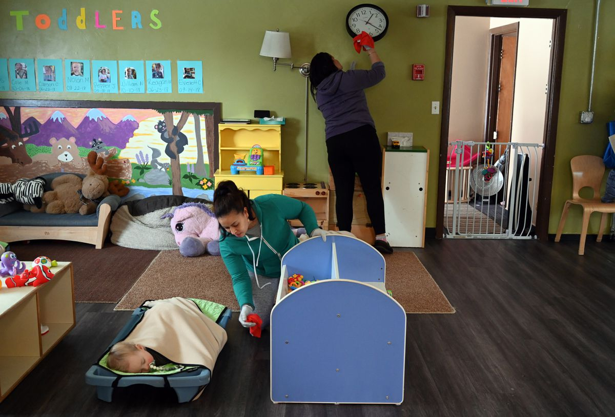 Carmen DeJesus, center, and Mary Gonzalez, back wall, clean walls and furniture during nap time at Hillcrest Children's Center, Monday, March 17, 2020. (Anne Raup / ADN)