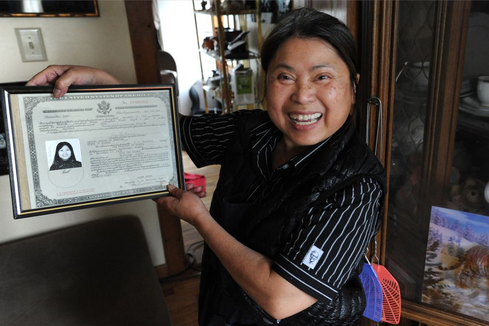 Tuoi Yungbauer displays her Certificate of Naturalization at her Mountain View home on Thursday, May 18, 2017. She became a U.S. citizen in 1978. (Bill Roth / Alaska Dispatch News)