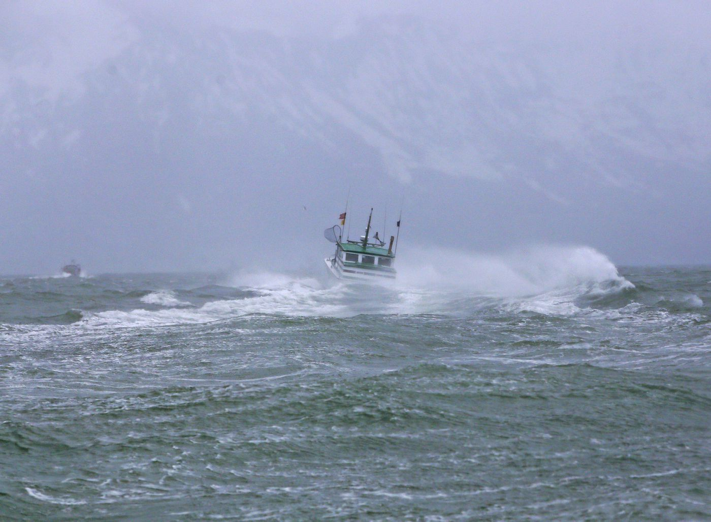 Fishermen leave the breakers and travel to calmer seas inside the sand bars of the Copper River flats while fishing for salmon during the season's second opener on Thursday, May 20, 2021. (Emily Mesner / ADN)