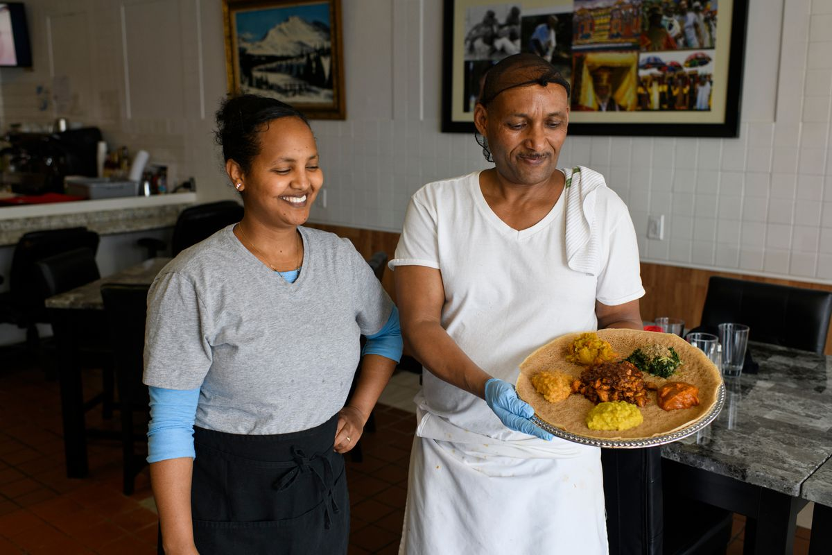 Samrawit Haile, left, and Dawit Ogbamichael operate Queen of Sheba Ethiopian restaurant. Queen of Sheba Ethiopian restaurant is located on Dawson Street near Benson Boulevard in Midtown Anchorage. Photographed on May 2, 2019. (Marc Lester / ADN)