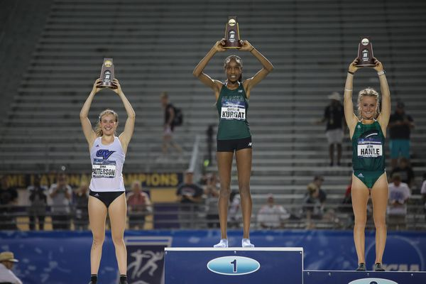 UAA's Caroline Kurgat stands atop the podium after winning the 5,000-meter run at the NCAA Division II championships in Kingsville, Texas, on Saturday, May 25, 2019.