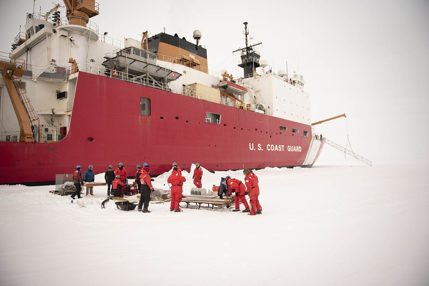 Scientists, engineers and crew members from the U.S. Coast Guard Cutter Healy prepare to unload gear on Oct. 2, 2018, about 715 miles north of Barrow, Alaska, in the Arctic. (U.S. Coast Guard photo by Senior Chief Petty Officer NyxoLyno Cangemi)
