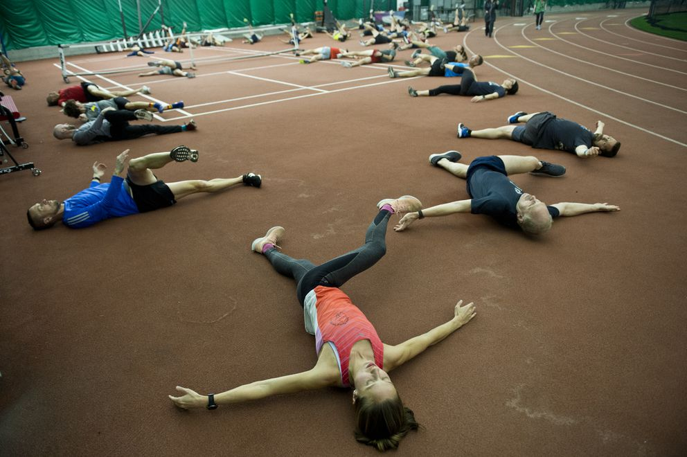 Members of the Alaska Endurance Project stretch at the start of a workout earlier this year at The Dome. (Marc Lester / ADN archive)