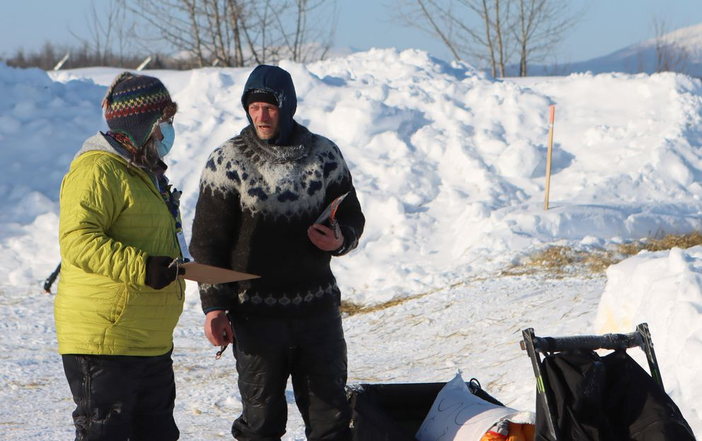 Dallas Seavey asked a race volunteer at the McGrath checkpoint Friday about overnight temperatures. He saw minus-50 on a thermometer he carries but figured it was a malfunction. In fact, it was probably correct. (Zachariah Hughes/for ADN)