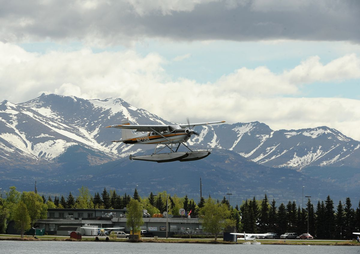 A floatplane takes off from Lake Hood Float Plane Base with the Chugach Mountains in the background in West Anchorage on Tuesday. (Bob Hallinen / ADN)