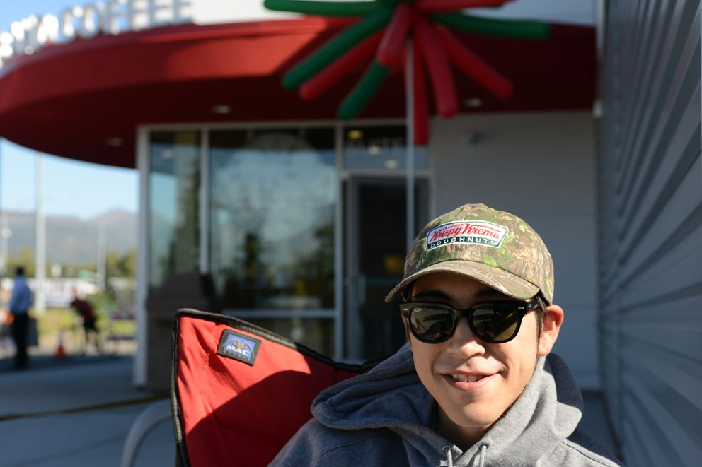 Bradley Honaker is camped out at the front of the line outside Krispy Kreme Doughnuts on Monday at Creekside in Muldoon. (Erik Hill / Alaska Dispatch News)