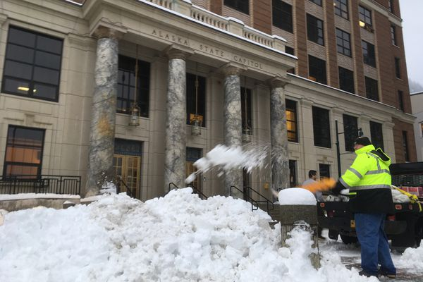 An Alaska Department of Administration employee shovels snow in front of the Alaska State Capitol on Monday, Jan. 21, 2019. Six inches of snow fell on Juneau Sunday, and four-tenths of an inch fell early Monday morning, according to figures provided by the National Weather Service office in Juneau. (James Brooks/ADN)