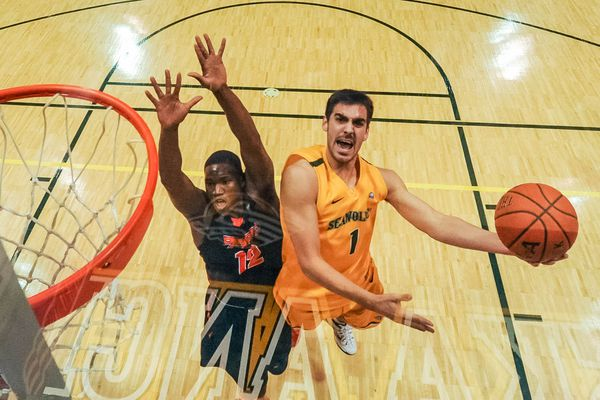 UAA's Christian Leckband goes for a basket while Pacific's Eric Thompson tries to block it during the first men's game of the GCI Great Alaska Shootout on Wednesday, November 26, 2014. Pacific won 71-62.
