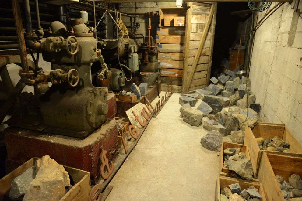The basement of Stewart's Photo holds signs of its past in downtown Anchorage on Wednesday. The building previously housed a meat market, and the cooling equipment is on the left. Blocks of jade tumble out of a room at right. (Bob Hallinen / ADN)
