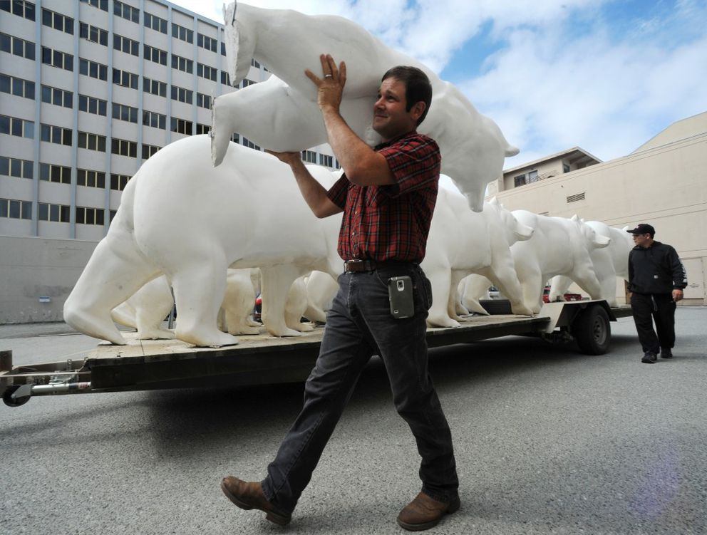 """Jeff Harrison delivers one of the 15 full-sized bear statues in downtown Anchorage on Sunday thatwill be decorated by local artists and displayed in a public art event titled """"Parade of Bears."""" (Bill Roth / Alaska Dispatch News)"""