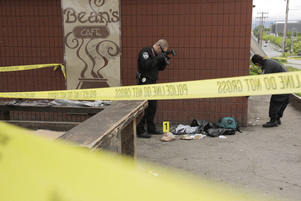 Anchorage police investigate the scene of a stabbing near Third Avenue and Karluk Street just before 8 a.m. Thursday, June 8, 2017. (Loren Holmes / Alaska Dispatch News)