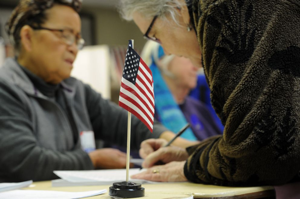 Election official Adelina Sanramon, left, signs in a voter at the Fairview Recreation Center polling place on Election Day, Tuesday, Nov. 6, 2018. (Bill Roth / ADN)