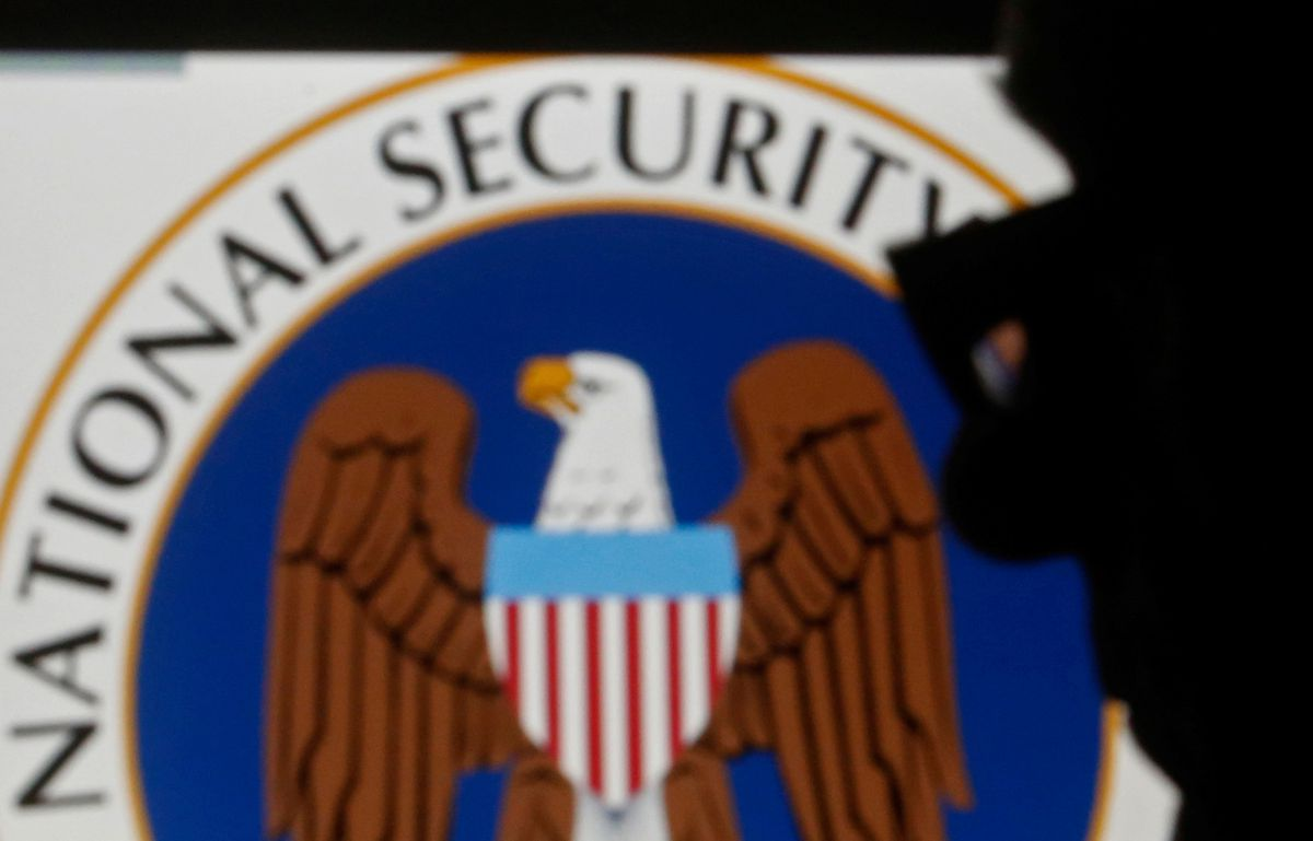 FILE: A man is silhouetted near a logo of the U.S. National Security Agency. REUTERS/Dado Ruvic