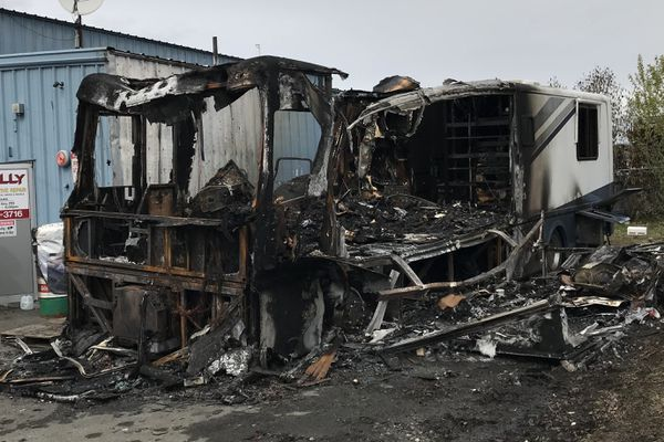 A man died in an early morning motorhome fire while the vehicle was parked next to an automotive repair business at West 58th Avenue and Arctic Boulevard on Sunday, May 12, 2019. (Bill Roth / ADN)