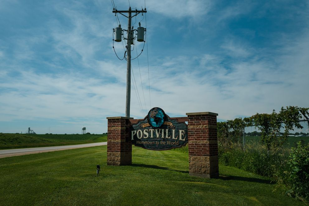 A town sign for Postville, Iowa, claims that it is 'Hometown to the World. ' (Photo by Ryan Christopher Jones for The Washington Post)