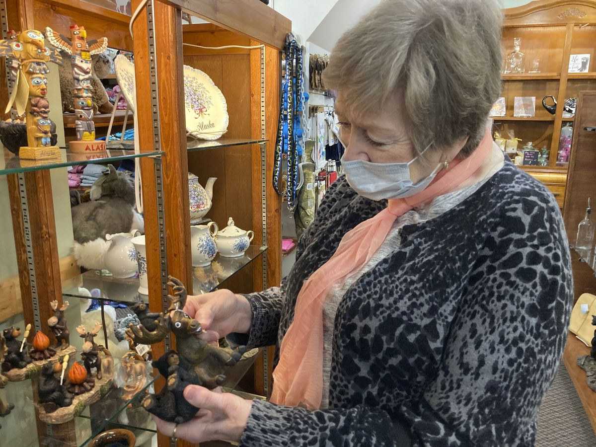 FILE - In this June 2, 2020, file photo, Donna Knight, of Wasilla, Alaska, shops at a tourist gift shop in Talkeetna, Alaska. Business owners in Talkeetna are hopeful that Alaskans will take the opportunity of so few tourists in the state this summer because of the coronavirus to help keep local tourism businesses afloat. (AP Photo/Mark Thiessen, File)