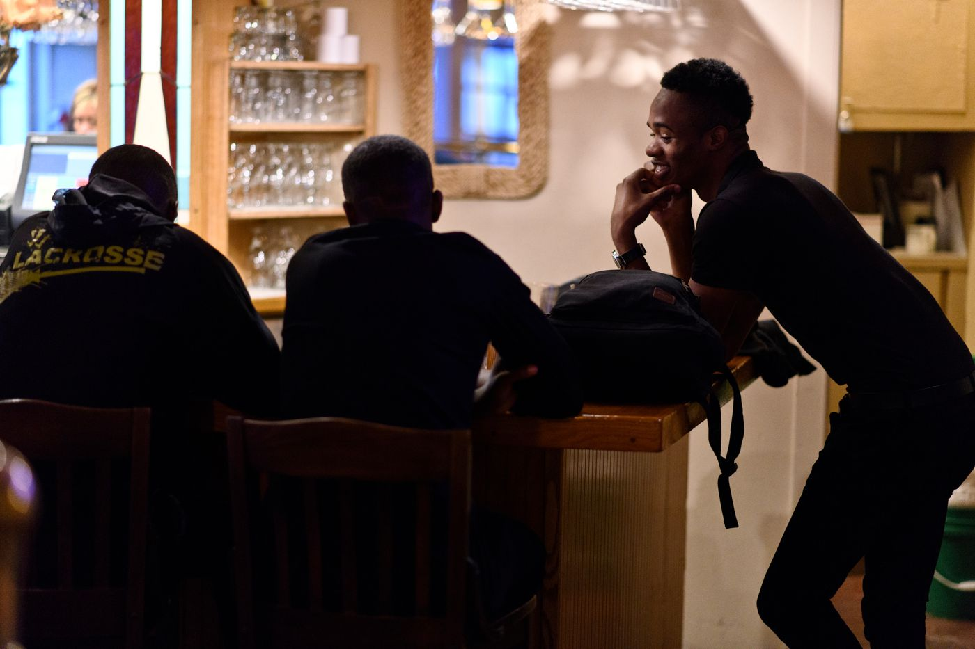 Odane Robinson, right, talks with his co-workers after his shift as a waiter at the Land's End Resort. (Marc Lester / ADN)