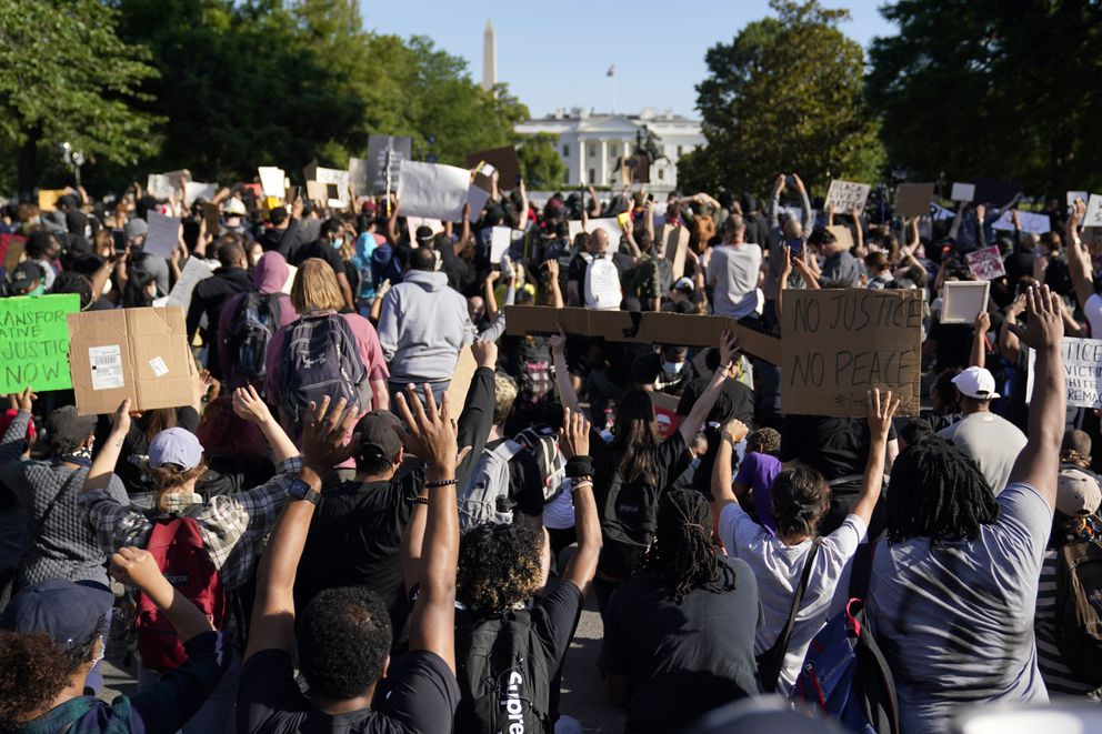 Demonstrators gather to protest the death of George Floyd, Monday, June 1, 2020, near the White House in Washington. Floyd died after being restrained by Minneapolis police officers. (AP Photo/Evan Vucci)