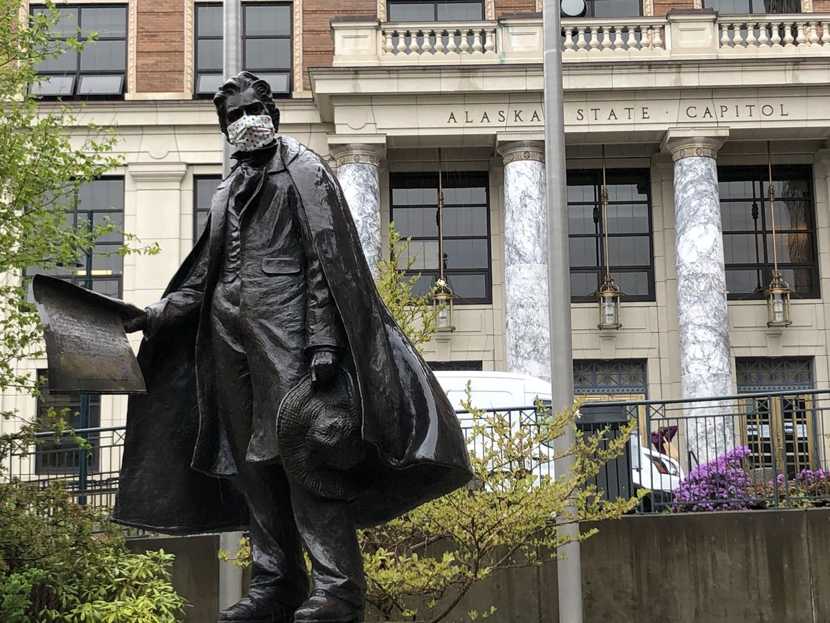 The statue of William Henry Seward wears a cloth mask in front of the Alaska State Capitol on Tuesday, May 19, 2020. (James Brooks / ADN)