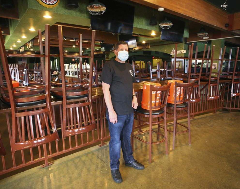 Robert Kilby stands inside an empty 907 Alehouse & Grill on July 20, 2020. The restaurant was closed and deep cleaned after an employee tested positive for COVID-19. (Emily Mesner / ADN)