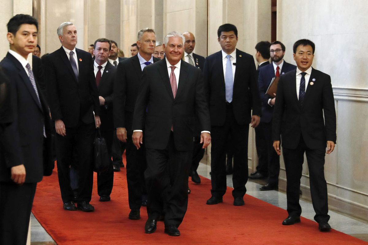 Secretary of State Rex Tillerson, center, arrives for a meeting with the Chinese foreign minister, in Beijing, Sept. 30, 2017. (Andy Wong/Pool via The New York Times)