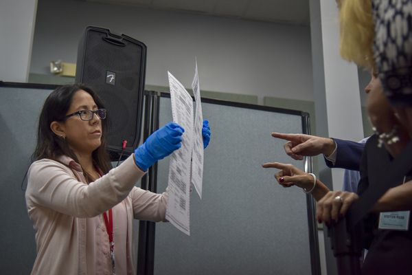 An election worker in Broward County shows to election observers ballots that have been damaged and duplicated in the recount for three statewide races. MUST CREDIT: Washington Post photo by Jahi Chikwendiu