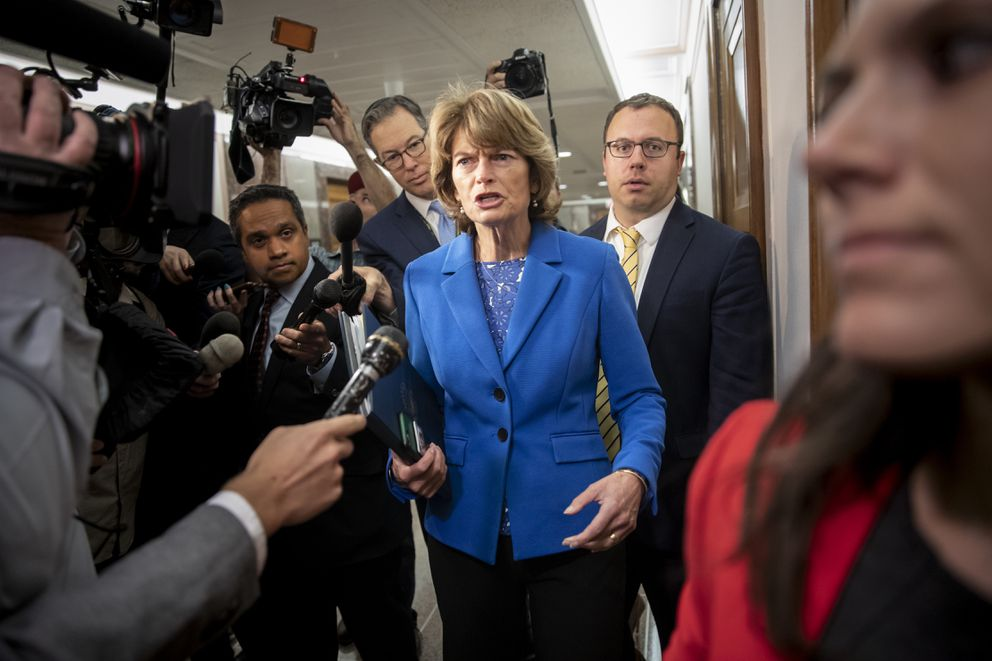 Arriving to chair the Senate Energy and Natural Resources Committee, Sen. Lisa Murkowski, R-Alaska, is pursued by reporters asking about her stand on President Donald Trump's embattled Supreme Court nominee, Brett Kavanaugh, on Capitol Hill in Washington, Tuesday, Sept. 25, 2018. (AP Photo/J. Scott Applewhite)