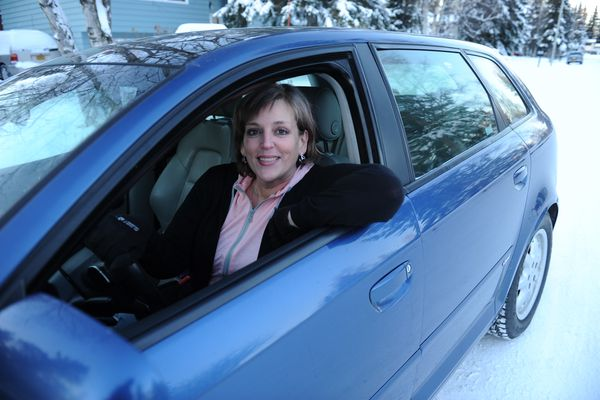 Robbin Muninger poses with her new car in east Anchorage, Alaska on Friday, Nov. 24, 2017. Muninger is a recovering addict and has taken out a loan for the first time to buy her car. (Bob Hallinen / ADN)