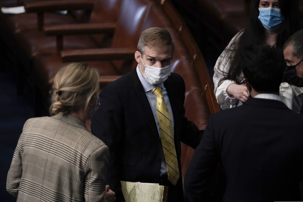 Rep. Jim Jordan, R-Ohio, talks with others after the U.S. House voted to impeach President Donald Trump in Washington, Wednesday, Jan. 13, 2021. Trump is charged with 'incitement of insurrection ' over the deadly mob siege of the Capitol in a swift and stunning collapse of his final days in office.(AP Photo/J. Scott Applewhite)
