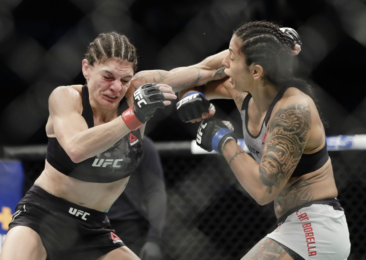 Italy's Mara Romero Borella blocks a punch by Anchorage's Lauren Murphy during the second round of a women's flyweight mixed martial arts bout at UFC Fight Night in Newark, N.J. (AP Photo/Frank Franklin II)