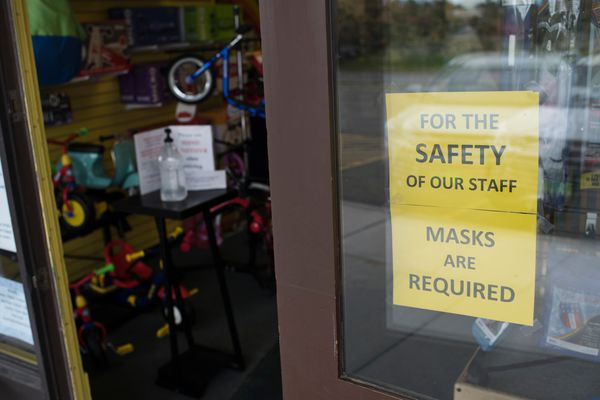 "A sign near the entrance to Over the Rainbow toy store alerts customers of the mask requirement on June 29, 2020. ""My bottom line is it's for the safety of my staff,"