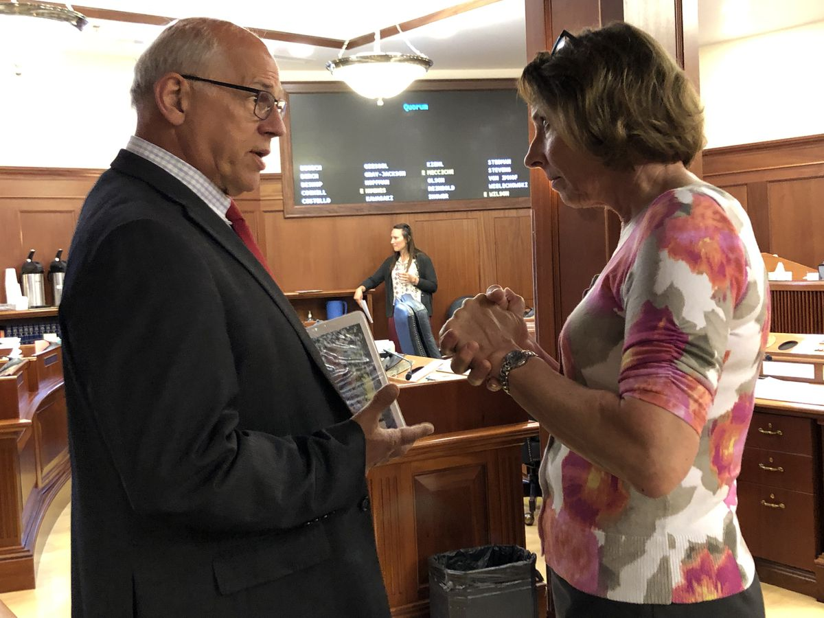 Sen. John Coghill, R-North Pole, and Sen. Cathy Giessel, R-Anchorage, speak before the start of a Senate floor session Tuesday, July 9, 2019. Both lost their races in the Republican primary this year. (James Brooks / ADN)