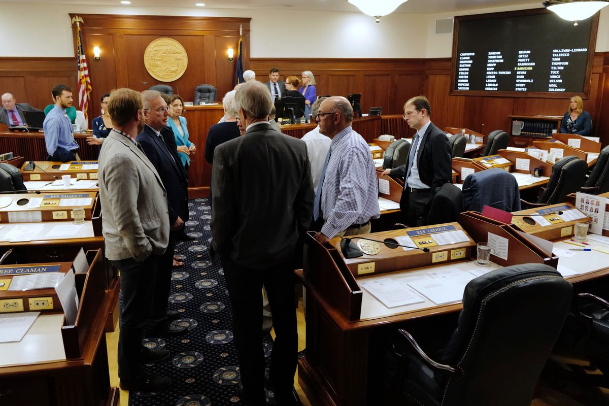 Lawmakers talk among themselves during a break of a joint session of the Alaska Legislature Thursday, July 11, 2019, in Juneau, Alaska. (Michael Penn/The Juneau Empire via AP)