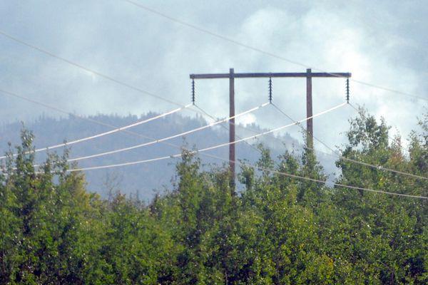 Smoke near power lines on the Kenai Peninsula during the Swan Lake Fire on Aug. 15, 2019. (Matt Tunseth / ADN)