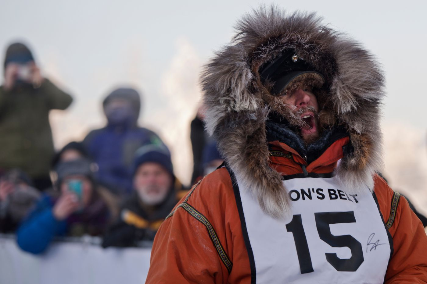 Brent Sass calls for his team to go during at start of the Yukon Quest International Sled Dog Race. (Marc Lester / Anchorage Daily News)