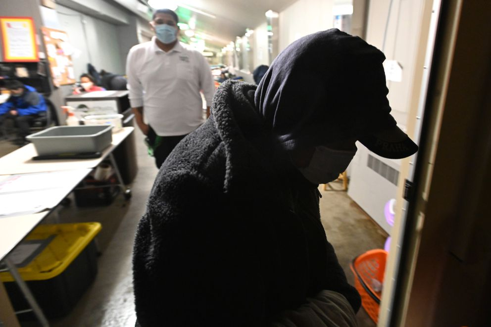 Ella Luther heads into the darkness after she was denied access to the Sullivan Arena homeless shelter when it reached full capacity on rainy Wednesday evening, Oct. 14, 2020. (Bill Roth / ADN)