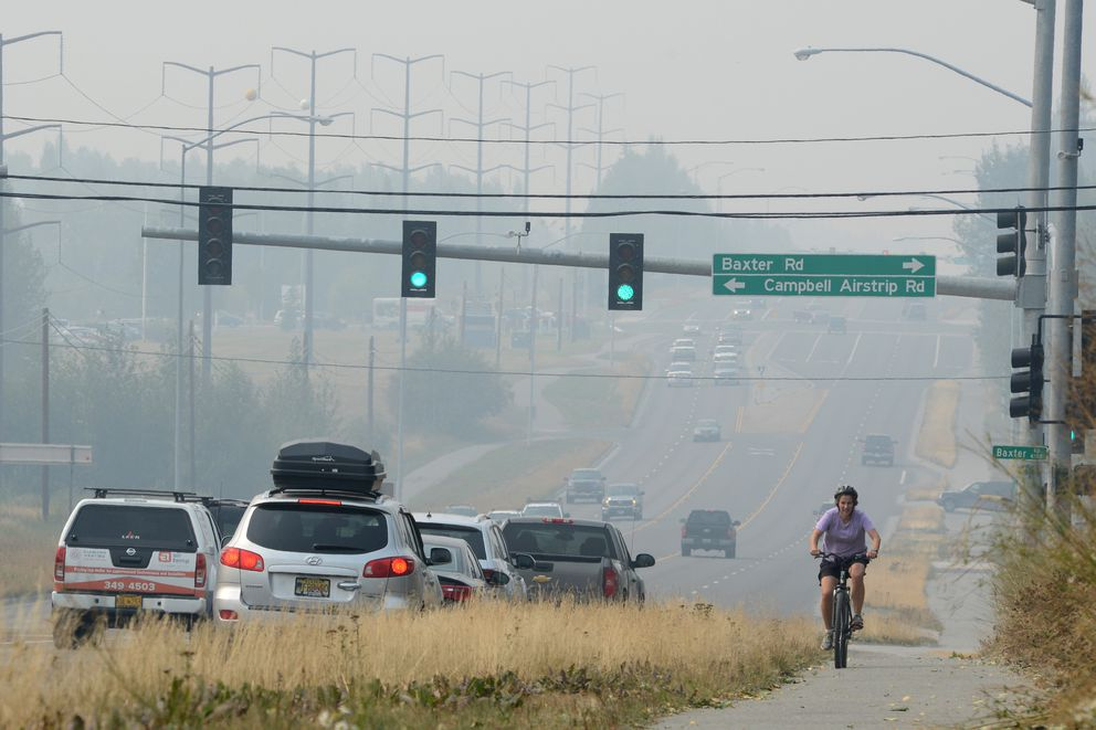 Smoke from Southcentral Alaska wildfires obscures views on Tudor Road in Anchorage Monday, Aug. 19, 2019. (Anne Raup / ADN)