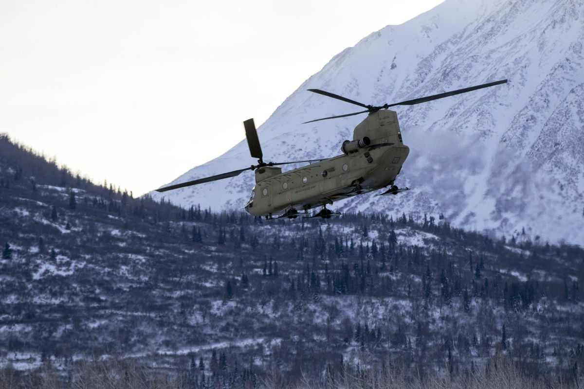 FILE - An Alaska National Guard CH-47 Chinook helicopter departs Joint Base Elmendorf-Richardson in 2020. (Spc. Grace Nechanicky/U.S. Army National Guard via AP)