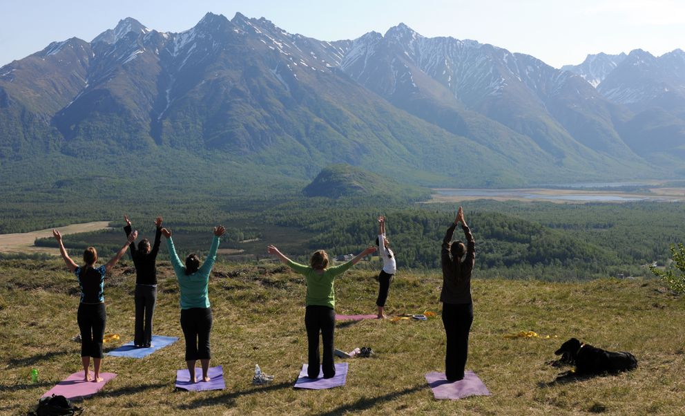 """Bright sunshine greets yoga practitioners participating in the first """"Yoga on the Butte"""" class sponsored by Blue Mountains Wellness Studio onBodenburg Butte in 2009. (Erik Hill / ADN archive 2009)"""