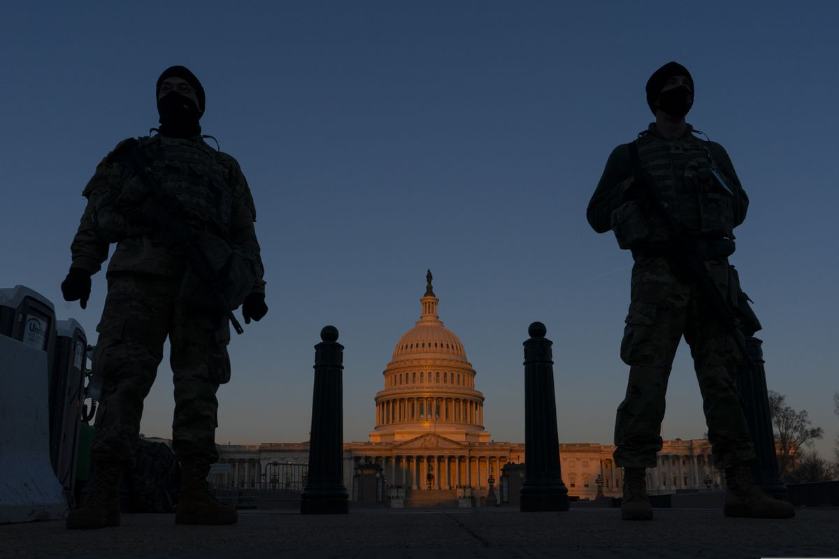 National Guard personnel stand outsaide the Capitol in March. (AP Photo/Carolyn Kaster, File)