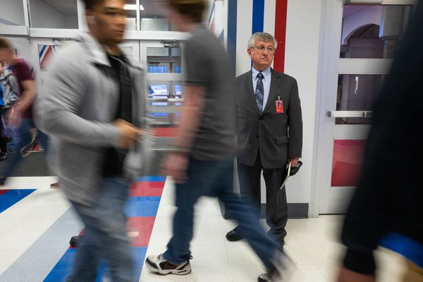 East High principal Sam Spinella monitors an entrance before the start of classes Thursday morning, April 5, 2018. (Loren Holmes / ADN)