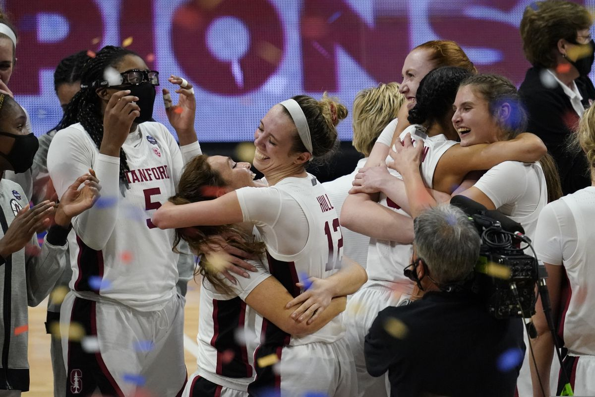 Stanford players celebrate at the end of the championship game against Arizona in the women's Final Four NCAA college basketball tournament, Sunday, April 4, 2021, at the Alamodome in San Antonio. Stanford won 54-53. (AP Photo/Eric Gay)