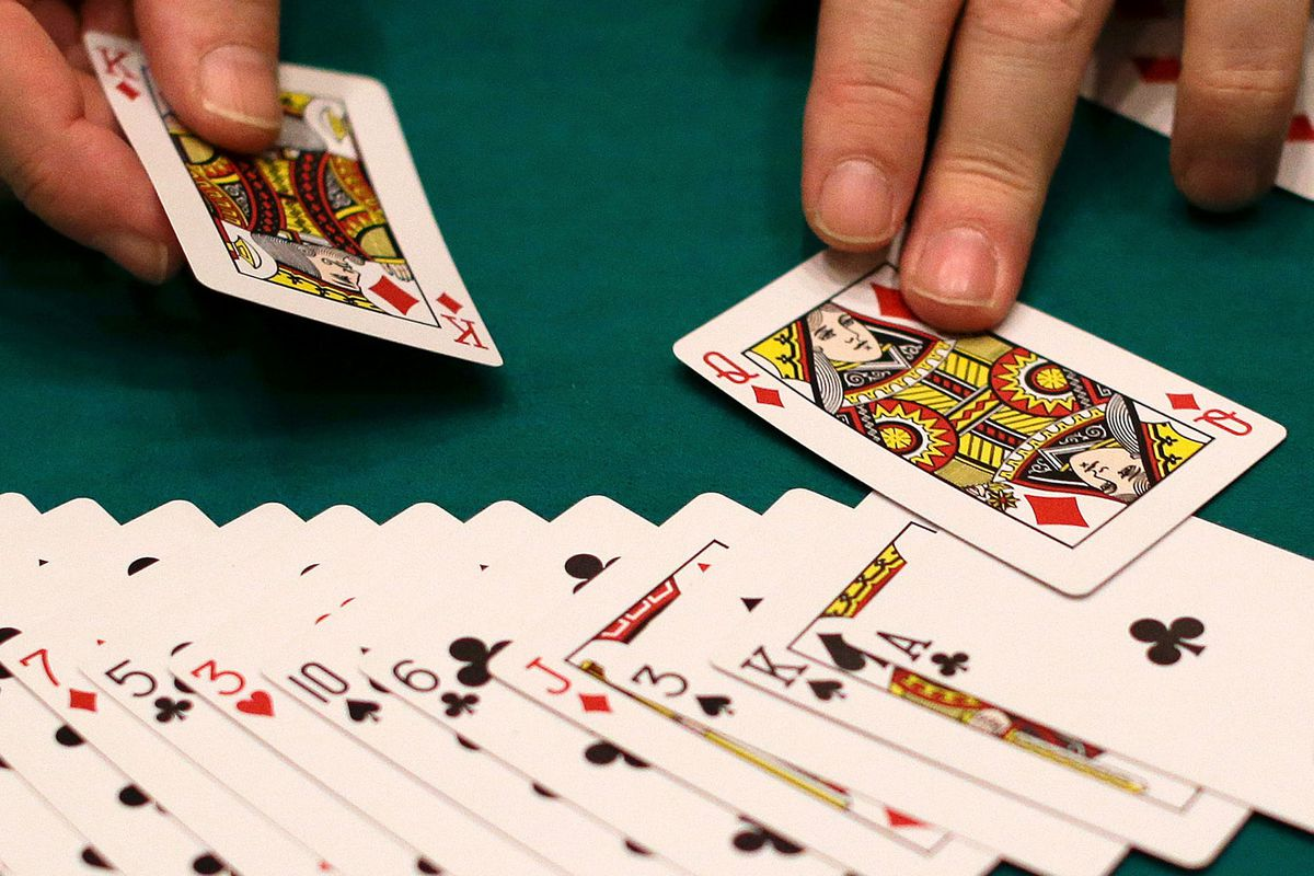 In this Wednesday, Feb. 27, 2013 file photo, a dealer resets a deck of cards at a casino in Las Vegas. (AP Photo/Julie Jacobson)